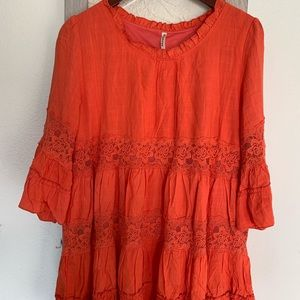 Women incredible and vibrant orange top